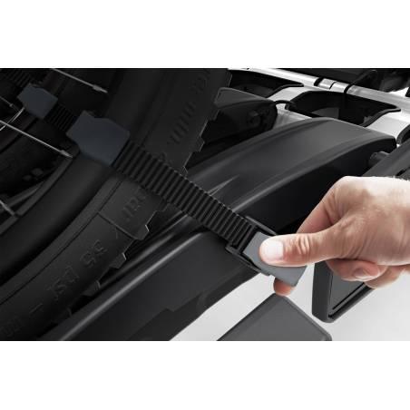 Boucles micro-clip réglables pour fixation rapide des roues et le transport de vélos de grande taille.